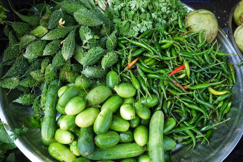 Many vegetable selling at street stall vendor at traditional agriculture market. Many vegetable selling at retail street stall vendor at traditional agriculture stock images