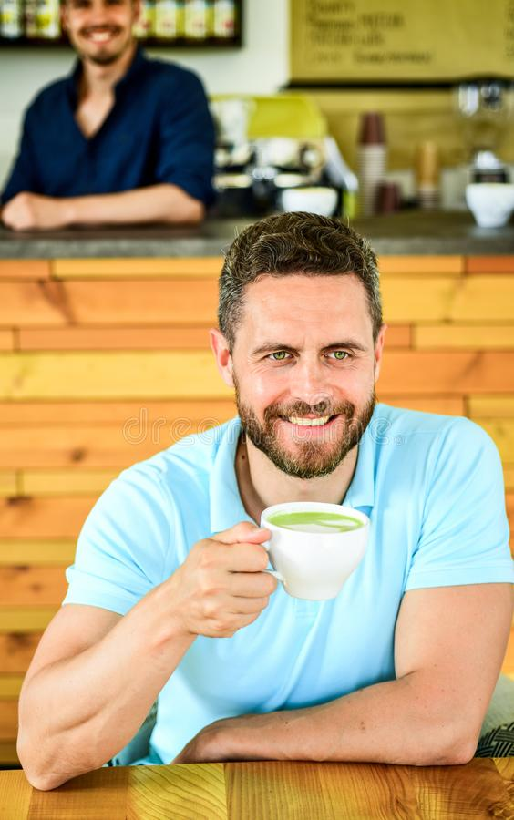 Many ways to enjoy coffee. Drink it black with milk or cream hot or cold. Add flavor or sweeteners. Man bearded guy royalty free stock images