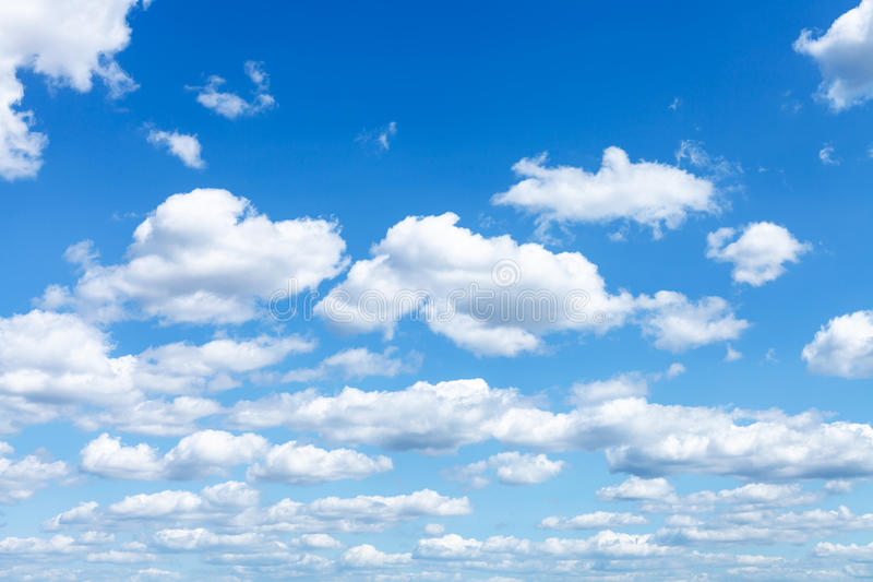 Many white clouds in summer blue sky. Natural background - many white clouds in summer blue sky royalty free stock images