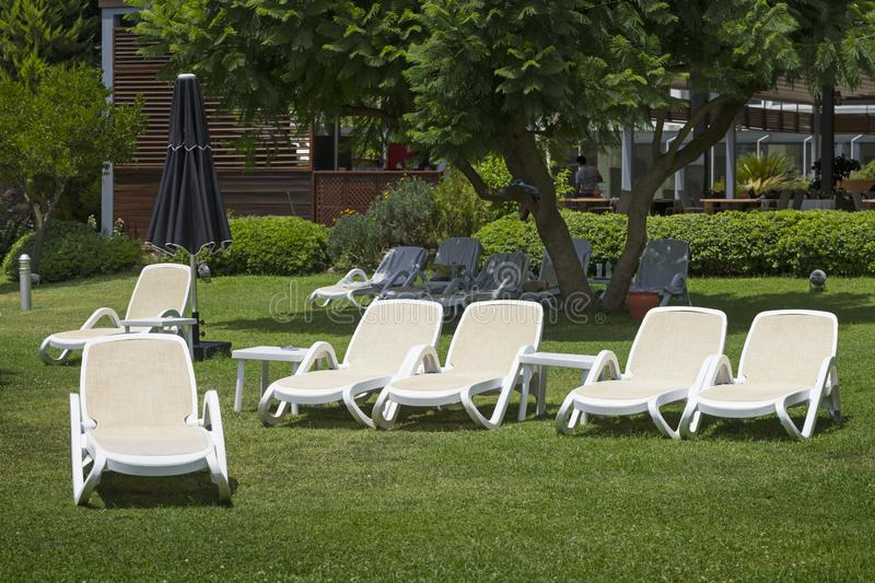 Many white deck chairs stock images