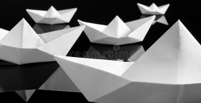 Many white paper boats stock images