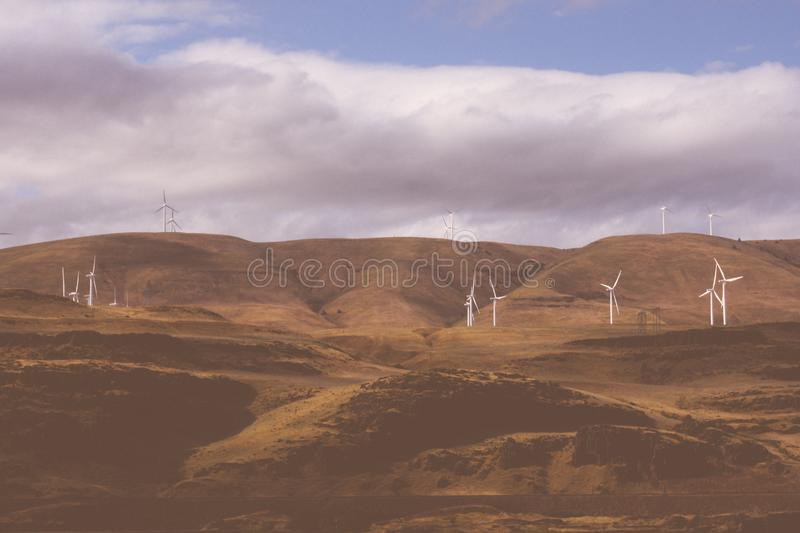 Multiple wind turbines in an agricultural field. Many wind turbines in an agricultural field royalty free stock photography