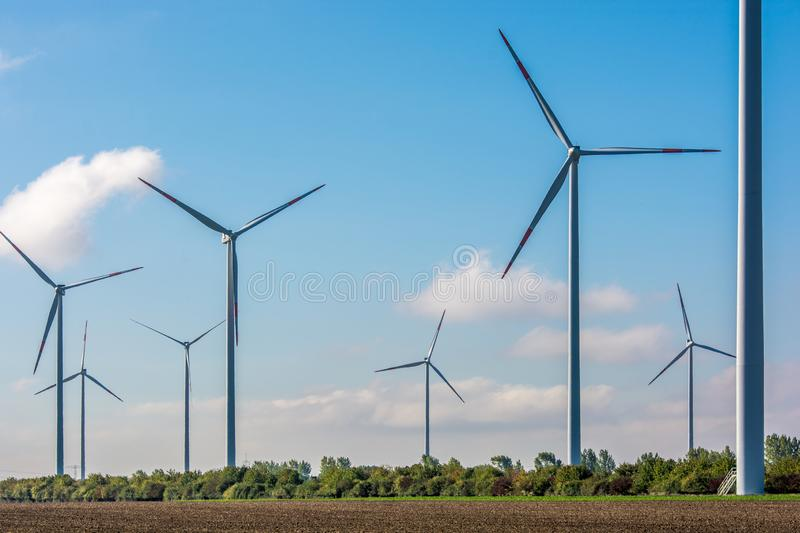 Large wind farm provides city with clean electricity royalty free stock images