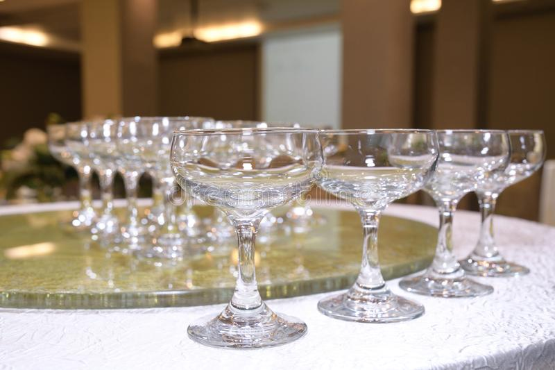 Many wine glasses arranged and aligned neatly in rows royalty free stock photo