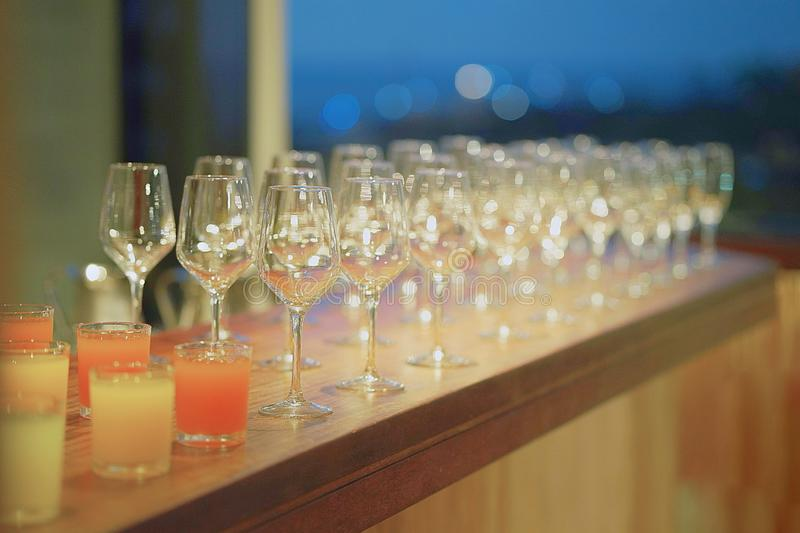 Many wine glasses on the bar table royalty free stock image