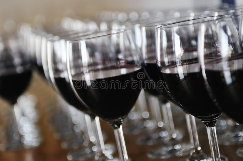 Many wine glasses in row stock photography