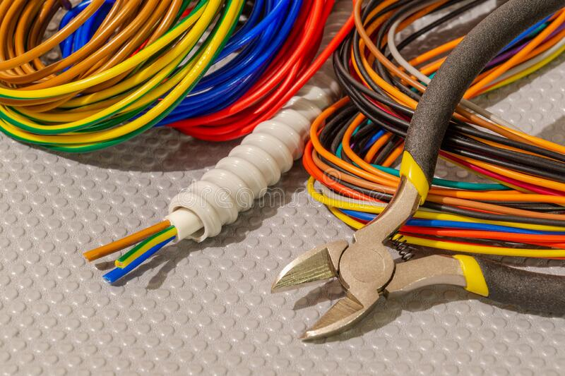 Many wires different color and tool for electrical repair stock photo