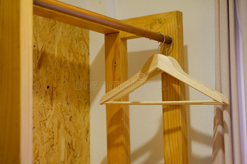 Many wooden hangers on a rod stock photography