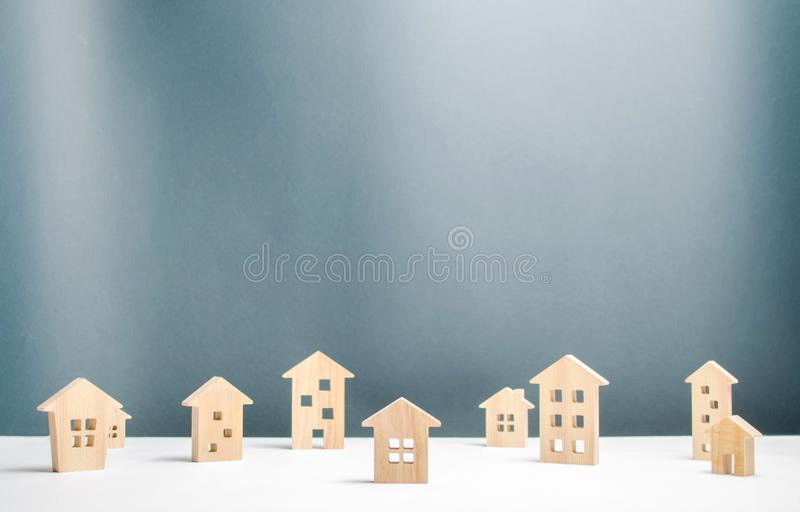 Many wooden houses. Settlement or town covered with snow. The concept of real estate and travel in the northern snow-covered. Settlements. Buying and selling royalty free stock images