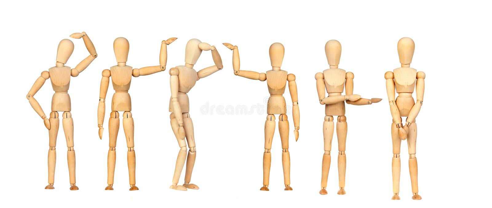 Many wooden mannequin doing differents gestures stock image