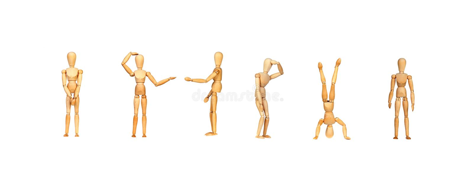 Many wooden mannequin doing differents gestures royalty free stock photo