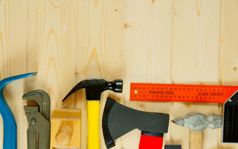 Many working tools on a wooden background. Working tools. Many working tools on a wooden background royalty free stock photography