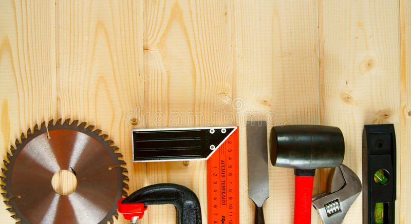 Many working tools on a wooden background. Working tools. Many working tools on a wooden background royalty free stock images