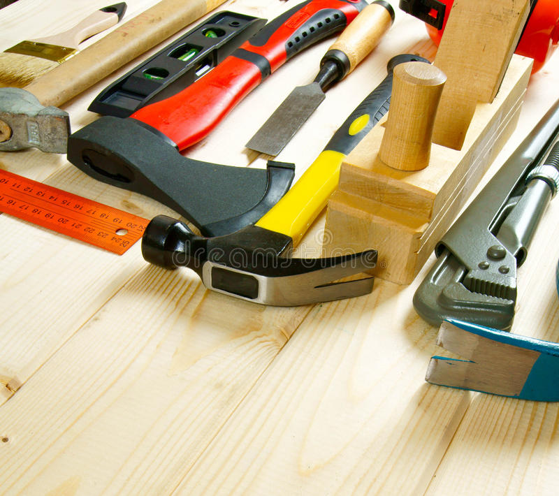 Many working tools on a wooden background. Working tools. Many working tools on a wooden background stock photography