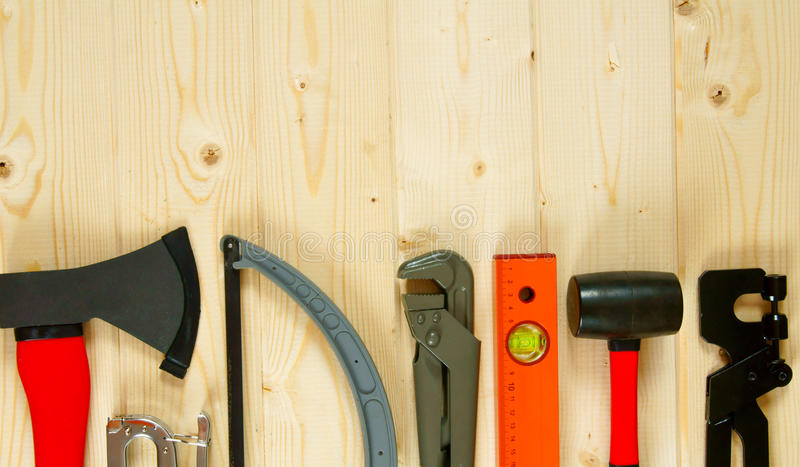 Many working tools on a wooden background. Working tools. Many working tools on a wooden background royalty free stock image