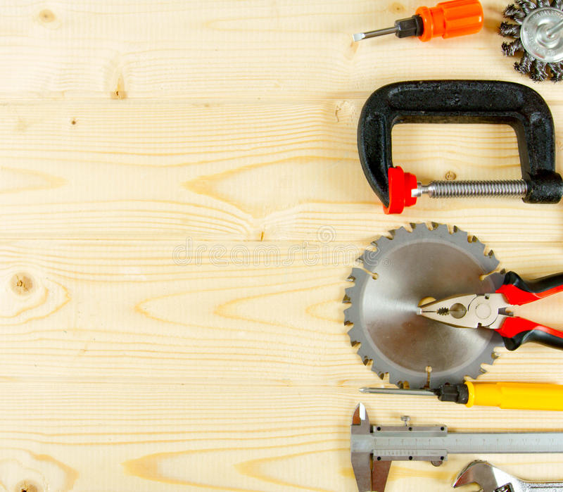 Many working tools on a wooden background. Working tools. Many working tools on a wooden background stock photos