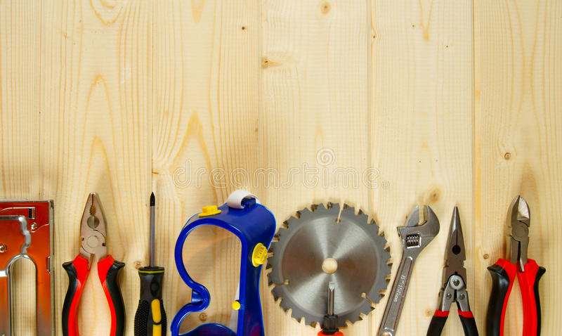 Many working tools on a wooden background. Working tools. Many working tools on a wooden background stock photo