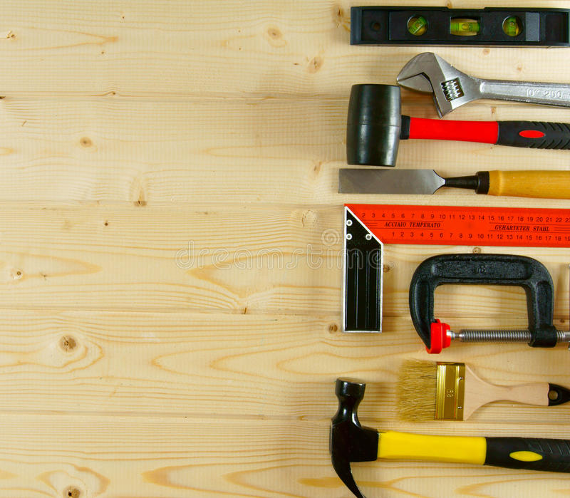 Many working tools on a wooden background. Working tools. Many working tools on a wooden background royalty free stock photos