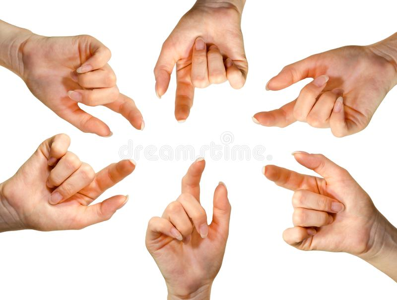 Many hands pointing to the center of the image in front of white background stock photos