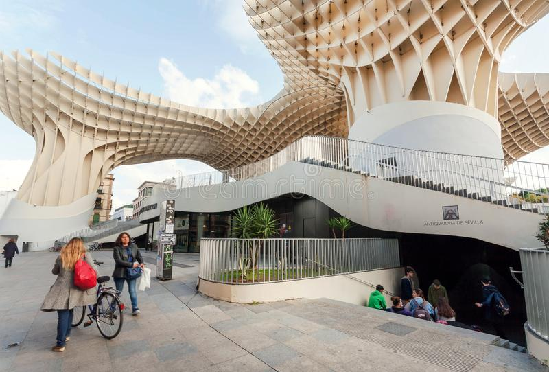 Many young people and pedestrians under the Metropol Parasol, urban project in the form of giant mushrooms stock photo
