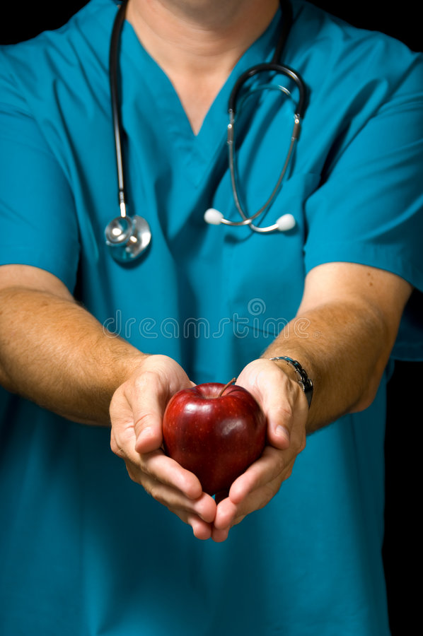 Manzana de ofrecimiento del doctor imagen de archivo libre de regalías