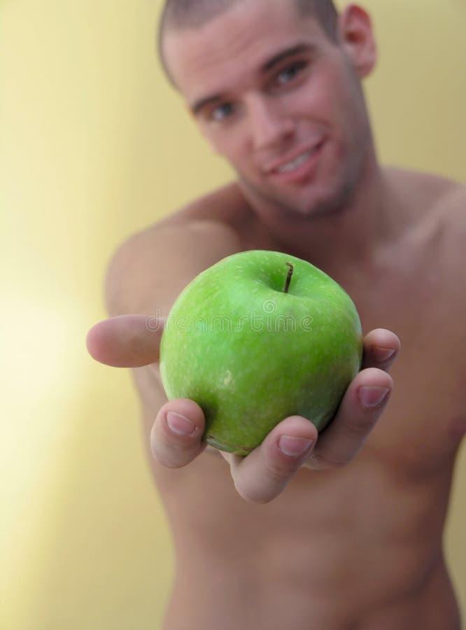 Manzana del asimiento del hombre imagen de archivo