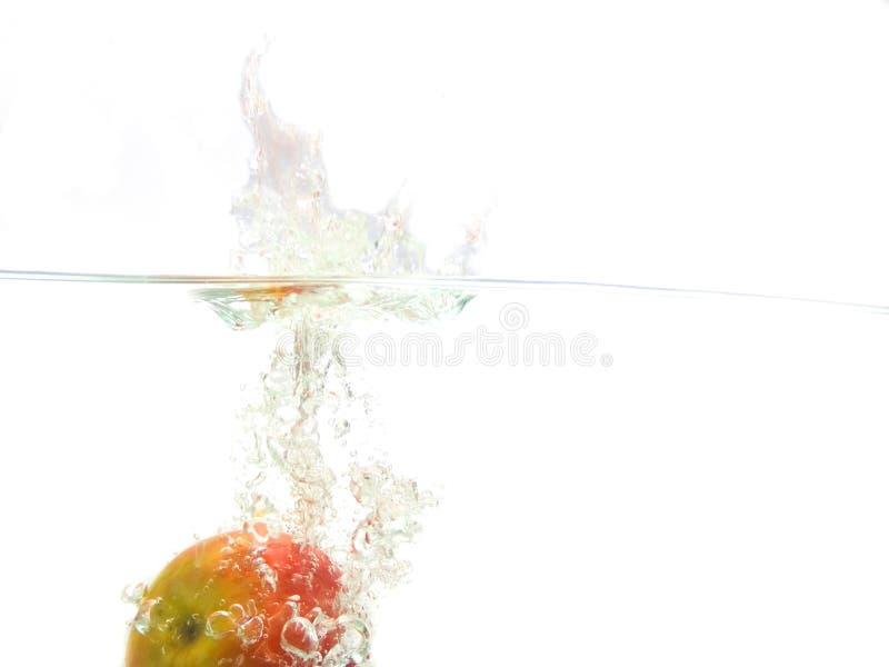 Manzana que cae fotografía de archivo