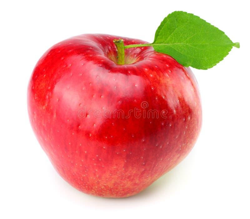 Manzana roja con la hoja verde aislada en un fondo blanco foto de archivo
