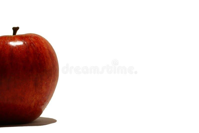Manzana roja en la cara fotografía de archivo libre de regalías