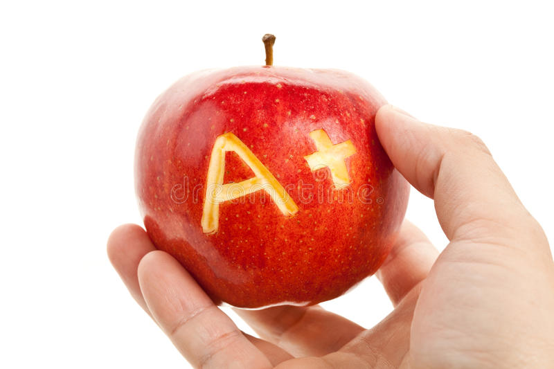 Manzana roja y un signo más foto de archivo libre de regalías