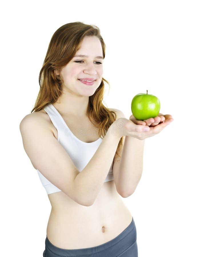 Manzana sonriente joven de la explotación agrícola de la muchacha imágenes de archivo libres de regalías