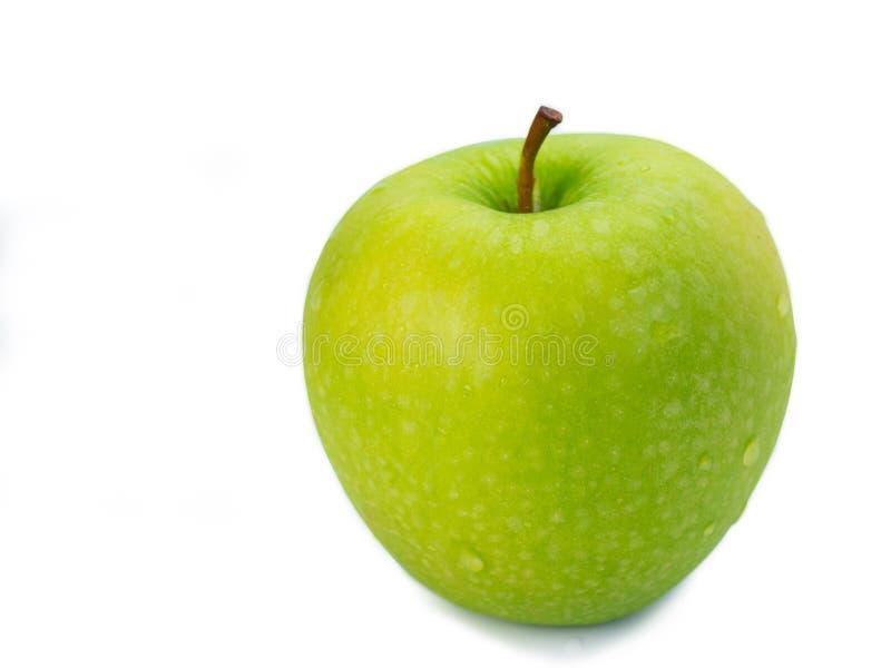 Manzana verde en el fondo blanco Trayectoria de recortes fotografía de archivo libre de regalías