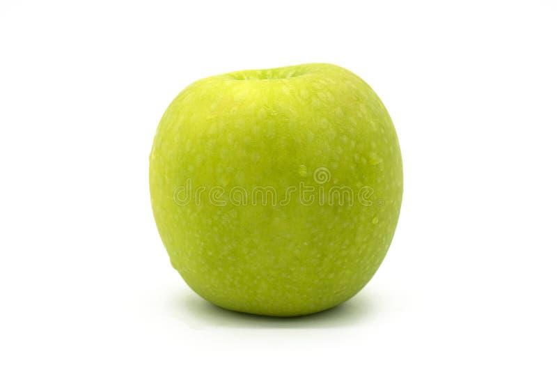 Manzana verde fresca del primer aislada en el fondo blanco del fichero con la trayectoria de recortes fotos de archivo