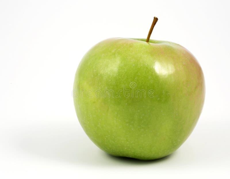 Manzana verde horizontal en blanco imagen de archivo