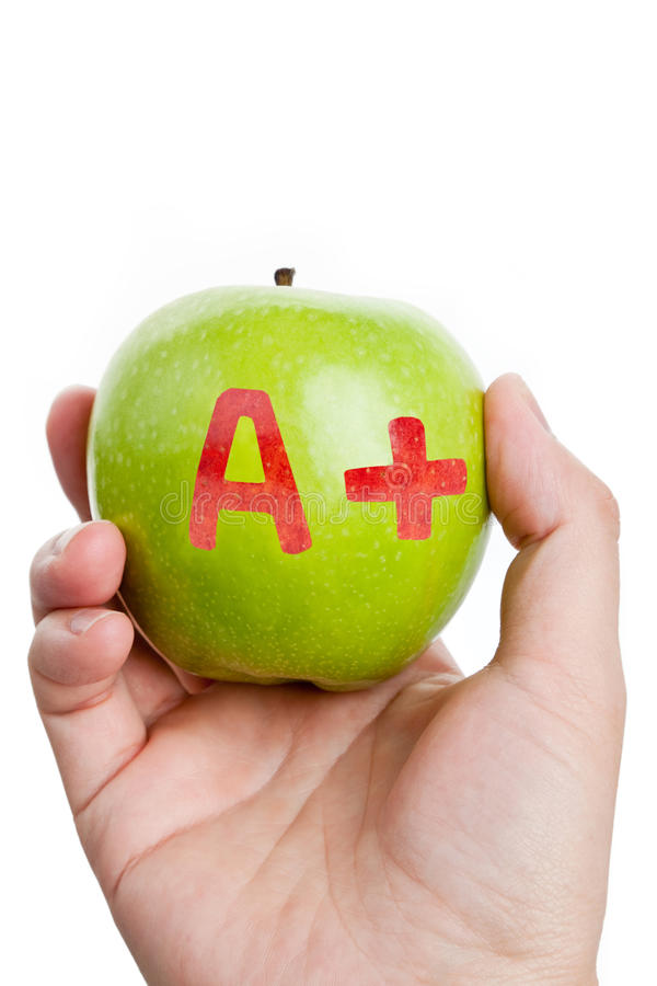 Manzana verde y un signo más foto de archivo
