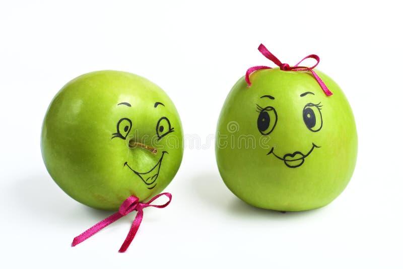 Manzanas con las caras cómicamente pintadas foto de archivo libre de regalías