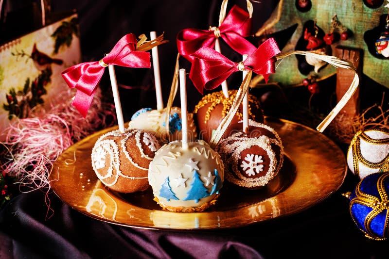 Manzanas en un palillo en el Año Nuevo foto de archivo