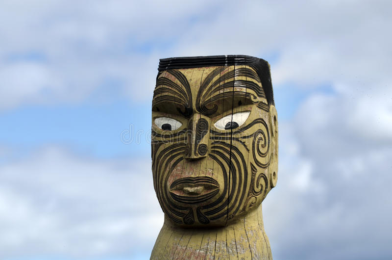Maori carving. Against white clouds in New Zealand stock images