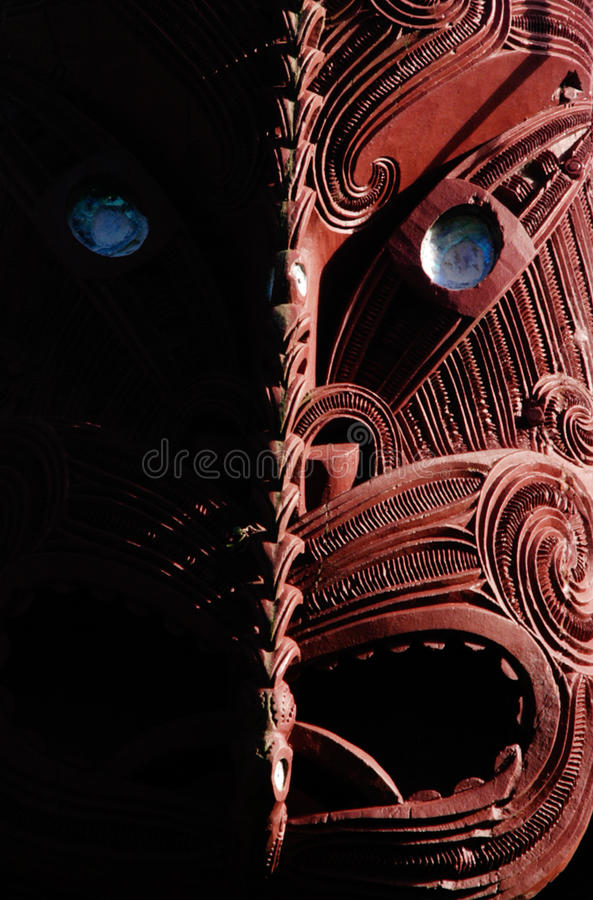 Maori Carving on a Marae. Traditional Maori wall carvings in a Marae (meeting house) New Zealand stock images