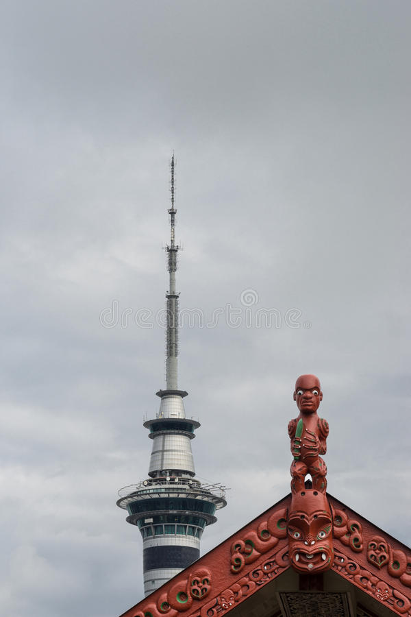Maori imagery and Sky Tower in Auckland. stock photo