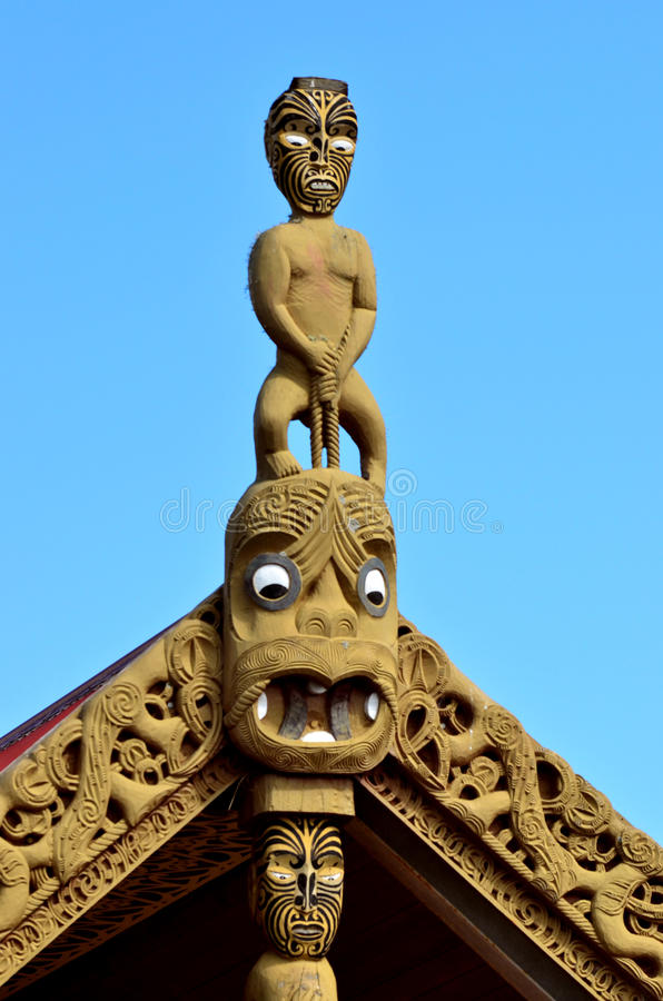 Maori Marae. Traditional Maori wood carvings in a Marae (meeting house) in New Zealand stock photography