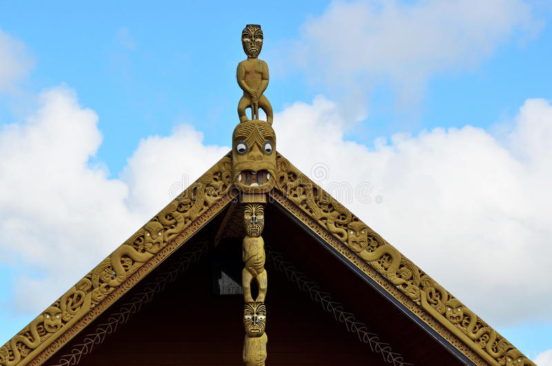 Maori Marae. Traditional Maori wood carvings in a Marae (meeting house) in New Zealand stock images