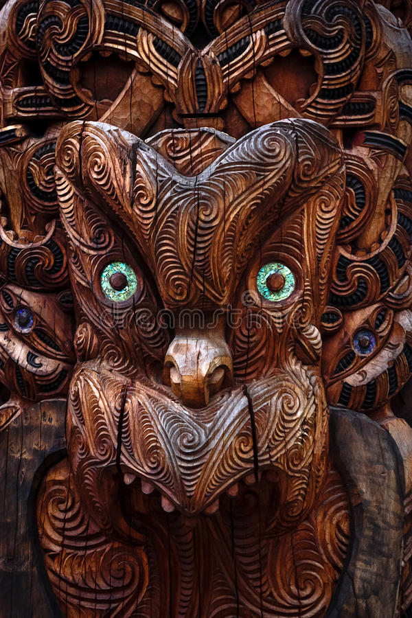 Maori Totem. Detail of a Maori warrior carved in a totem pole royalty free stock photo