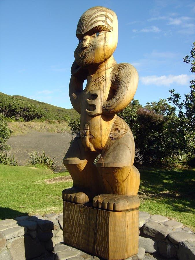 Maori totem on Karekare Beach royalty free stock photo