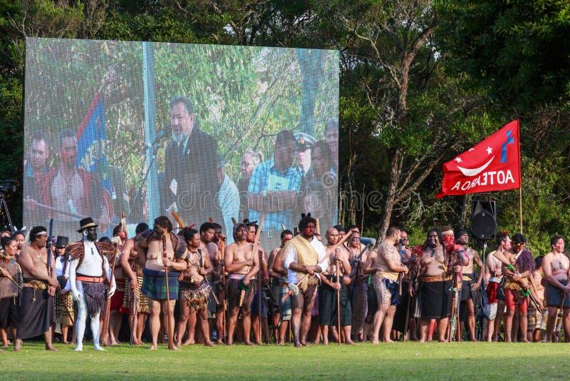 Maoristrijders bij de 150ste verjaardagsherdenking van de slag van Poortpa stock afbeelding