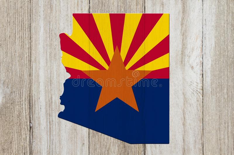 Map of Arizona in the Arizona flag colors. On weathered wood royalty free stock photography