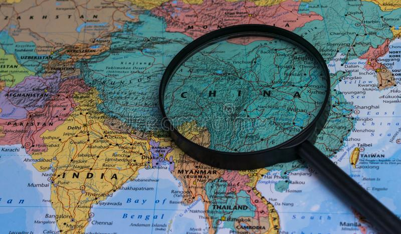Map of china through magnifying glass on a world map stock photo download map of china through magnifying glass on a world map stock photo image gumiabroncs Images