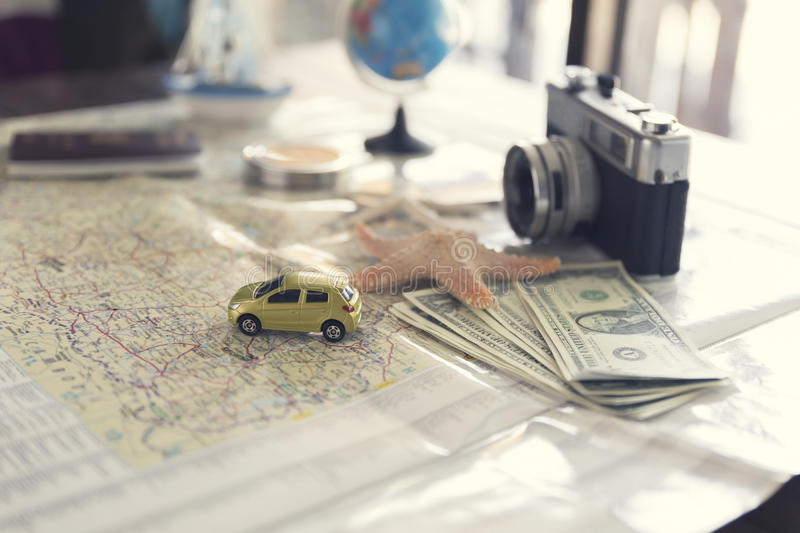 Map, compass, passport, banknote, globe, camera, ship car and st. Map, compass, passport, banknote money, globe, camera, car ship and starfish figurine on wooden royalty free stock images