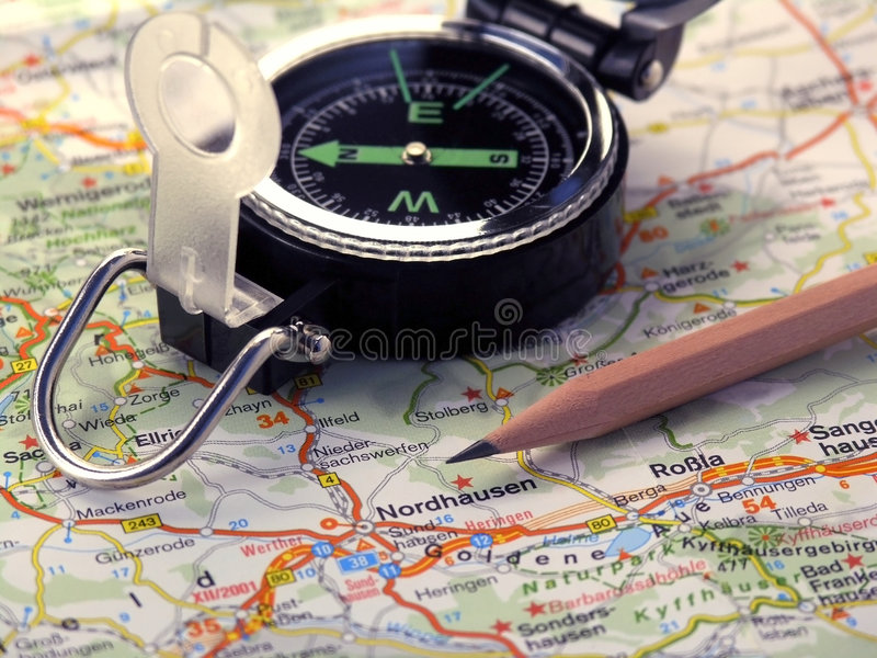 Map, compass and pencil. royalty free stock photos