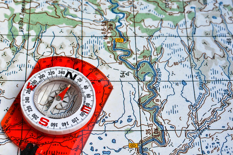 Map and compass. stock images